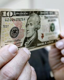 Тенге укрепился к доллару до рекордной отметки с начала года - финансы